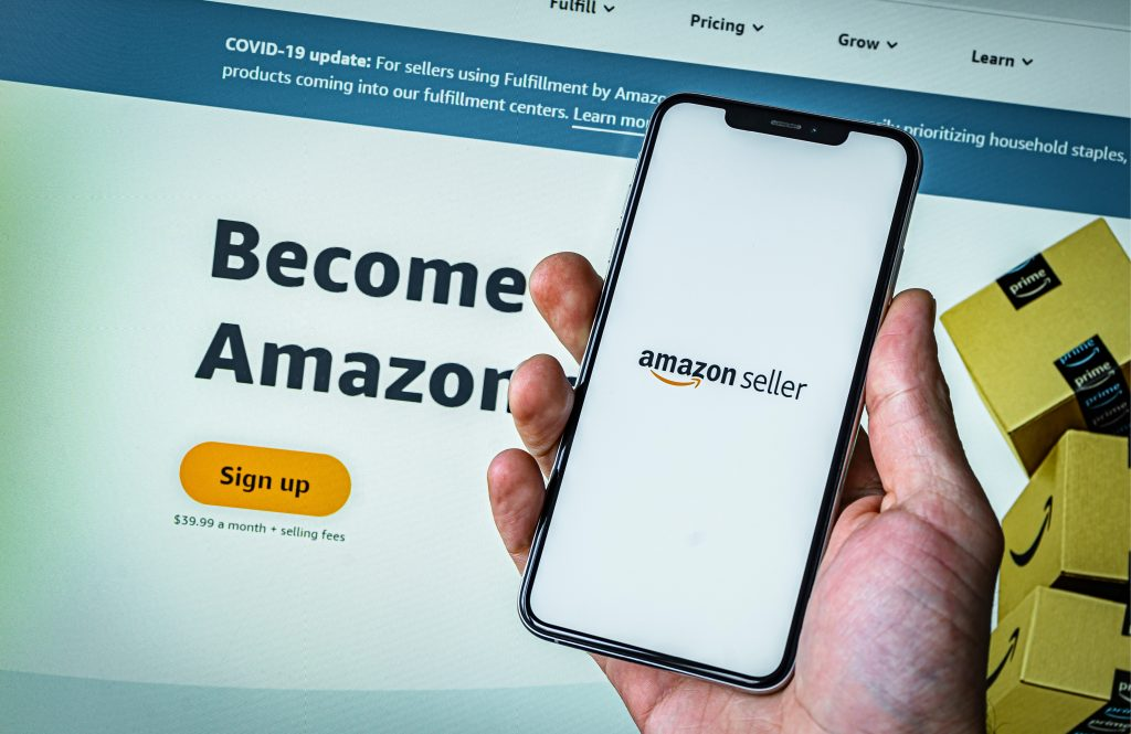 Hand holding a smartphone creating an Amazon account